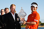 PALM BEACH GARDENS, FL. - Gary Nicklaus presents Y.E. Yang with the winner's trophy for the 2009 Honda Classic - PGA National Resort and Spa in Palm Beach Gardens, FL. on March 8, 2009.