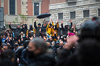 """Rome, Italy. 12th Apr, 2021. Today, Hospitality Industry workers, Autonomous workers (Partite IVA, VAT Workers), Gym owners, supported by far-right extremist movements and political parties held a demonstration in Piazza San Silvestro, near the Italian Parliament, to highlight the dramatic situation of workers in Italy during the ongoing pandemic Covid-19/Coronavirus, to call for an immediate reopening (The slogan of the demo was: """"Io Apro"""", I Open) of their economic activities, and to call the Italian Government, led by Prof. Mario Draghi, to act for immediate investments, aids (Ristori), and policies to save their industry, and the whole Country. A large number of full riot gears police officers and vehicles, assisted by a water cannons truck and a helicopter were deployed at protection of the Parliament due to a similar violent demo which was held on the 06th of April (1.) in Piazza Montecitorio. The tension between protesters and police officers erupted when a group of protesters tried to force their way to reach the Parliament, full riot gears police officers confronted and pushed them back while glass and plastic bottles, dangerous firecrackers, smoke bombs and flares, placards, were thrown towards the officers. <br /> <br /> Footnotes & Links: <br /> 1. 06.04.2021- Hospitality Demo Outside Italian Parliament Erupts In Violent Clashes With Police https://lucaneve.photoshelter.com/gallery/06-04-2021-Hospitality-Demo-Outside-Italian-Parliament-Erupts-In-Violent-Clashes-With-Police/G0000y2RXXo96Jkk/C0000GPpTqAGd2Gg"""