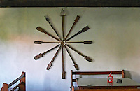 Wall decoration: different old-fashioned traditional kitchen utensils shaped as a star. Tradita traditional restaurant, Shkodra. Albania, Balkan, Europe.