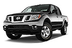 Low aggressive front three quarter view of a 2013 Nissan Frontier Crew Cab SV 4wd2013 Nissan Frontier Crew Cab SV 4wd