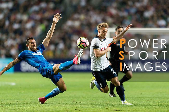 Tottenham Hotspur Midfielder Christian Eriksen (R) fights for the ball with SC Kitchee Defender Nando (L) during the Friendly match between Kitchee SC and Tottenham Hotspur FC at Hong Kong Stadium on May 26, 2017 in So Kon Po, Hong Kong. Photo by Man yuen Li  / Power Sport Images