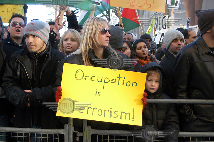 Angry pro-Palestinian demonstrators in front of the Royal Ontario Museum shout at pro-Israeli protesters who had gathered in front of the Israeli embassy. The protests were in response to the missile strikes from both Hamas and Israel at the end of 2008.