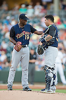 Scranton/Wilkes-Barre RailRiders starting pitcher Luis Severino (19) checks on catcher Gary Sanchez (35) after he was hit in the mask by a foul ball during the game against the Charlotte Knights at BB&T BallPark on July 20, 2016 in Charlotte, North Carolina.  The RailRiders defeated the Knights 14-2.  (Brian Westerholt/Four Seam Images)
