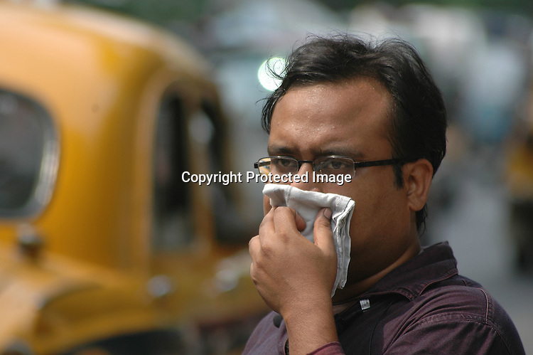 INDIA (West Bengal - Calcutta)  2007, An Indian man covers his nose with his handkerchief. Heavy polluted areas cause nose and eye burning. A recent report by CNIC (CHITTARANJAN NATIONALCANCER INSTITUTE)  one of the most prominent cancer Institue of the country declairs Calcutta has the most air pollution in the country and 70% of its population suffers from respiratory and lung diseases. - Arindam Mukherjee