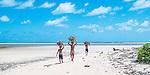 Kids carrying firewood on Biketawa. Tarawa, Kiribati