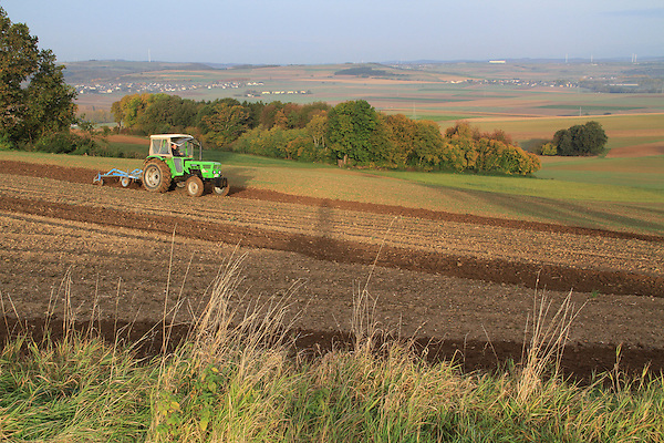 Tractor and farmland near Burg Eltz Castle above the Mozel River Valley, Baccarat, France