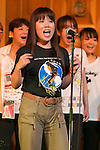 A woman sings Michael Jackson's songs during the MJ A-Live! at Odaiba on June 21, 2015, Tokyo, Japan. MJ A-Live! is an annual tribute to Michael Jackson in Tokyo, where fans wear Michael Jackson costumes and dance to the choreographies of the King of Pop who died on June 25, 2009. (Photo by Rodrigo Reyes Marin/AFLO)