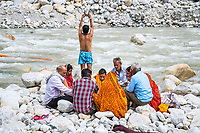 Hindu pilgrims at the holy Ganges River in Gangotri, India