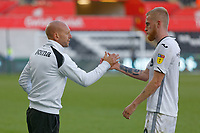 Adrian Tucker, goalkeeping coach for Swansea congratulates Oli McBurnie after the Sky Bet Championship match between Swansea City and Queens Park Rangers at the Liberty Stadium, Swansea, Wales, UK. Saturday 29 September 2018