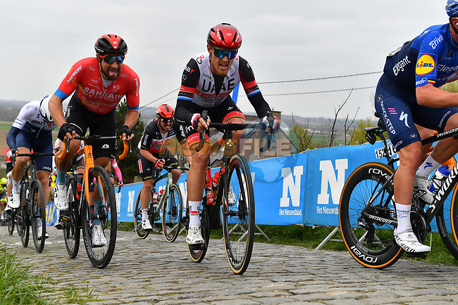 Matteo Trentin (ITA) UAE Team Emirates and Marco Haller (AUT) Bahrain Victorious climb the Paterberg during the 2021 Tour of Flanders running 254.3km from Antwerp to Oudenaarde, Belgium. 4th April 221.  <br /> Picture: Serge Waldbillig | Cyclefile<br /> <br /> All photos usage must carry mandatory copyright credit (© Cyclefile | Serge Waldbillig)
