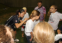 Homare Sawa #10 of the Washington Freedom signs autographs during a WPS match against the Philadelphia Independence on August 4 2010 at the Maryland Soccerplex, in Boyds, Maryland. Freedom won 2-0.