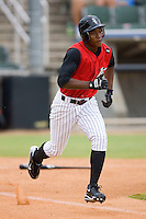 Brandon Short #13 of the Kannapolis Intimidators hustles down the first base line versus the Rome Braves at Fieldcrest Cannon Stadium July 28, 2009 in Kannapolis, North Carolina. (Photo by Brian Westerholt / Four Seam Images)
