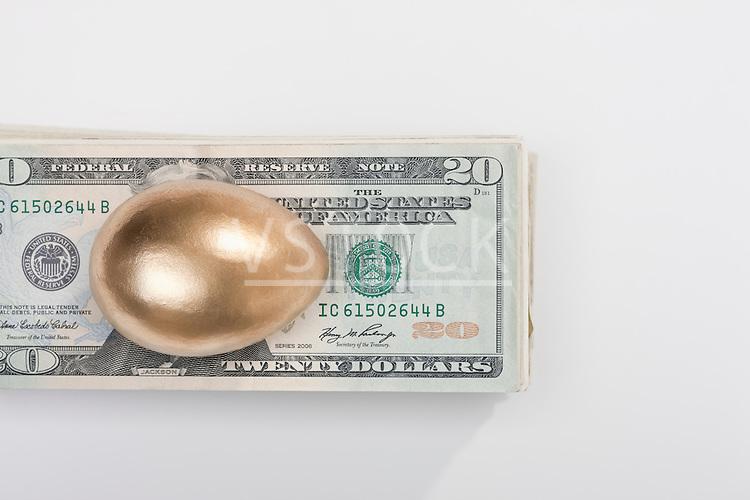 USA, Illinois, Metamora, Golden egg on top of US money