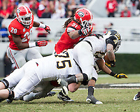 The Georgia Bulldogs beat the App State Mountaineers 45-6 in their homecoming game.  After a close first half, UGA scored 31 unanswered points in the second half.  Appalachian State Mountaineers running back Marcus Cox (14), Georgia Bulldogs linebacker Ramik Wilson (51)