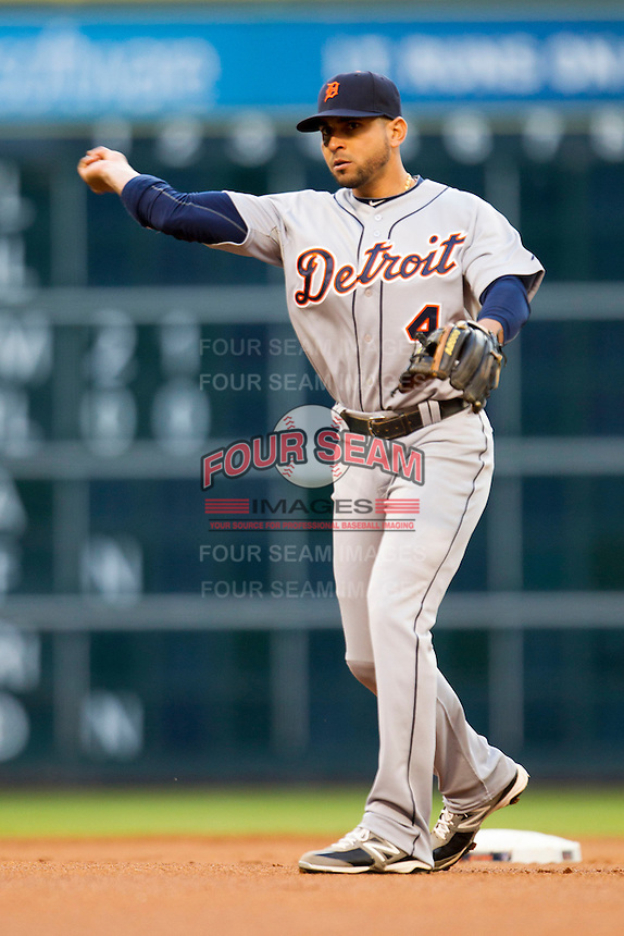 Detroit Tigers second baseman Omar Infante (4) makes a throw to first base during the MLB baseball game against the Houston Astros on May 3, 2013 at Minute Maid Park in Houston, Texas. Detroit defeated Houston 4-3. (Andrew Woolley/Four Seam Images).