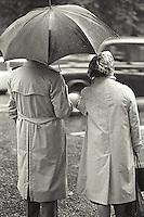Couple under unbrella in the rain<br />