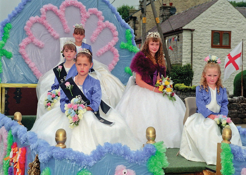 """Junior Queen of the Peak, Lauren Britain-Cartiledge escorted by the court of Chapel En Le Frith; Junior Queen Charlotte Jodrell, Princess Jasmine Fleming, Rosebud Kelsey Binning, and attendant Connie Oxbury.<br /> <br /> """"The event was held at Chapel-en-le-Faith Methodist Church, in front of invited visiting Village and charity royalty from around the Derbyshire and High Peak area. Due to not having Derbyshire Royalty for 2012/13 the Court of Queens part of the event was kindly hosted by Junior Queen of the Peak Lauren, who welcomed visiting Royalty from Derbyshire and surrounding areas along with Charity Royalty."""""""