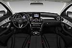 Stock photo of straight dashboard view of a 2017 Mercedes Benz C Class C350e 4 Door Sedan