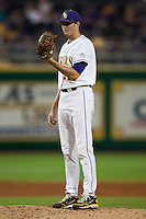 LSU Tigers starting pitcher Kevin Gausman #12 prepares to deliver against the Mississippi State Bulldogs during the NCAA baseball game on March 16, 2012 at Alex Box Stadium in Baton Rouge, Louisiana. LSU defeated Mississippi State 3-2 in 10 innings. (Andrew Woolley / Four Seam Images)