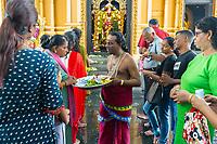 Hindu Priest Receiving Donations in front of Sri Venkatesha Perumal Shrine, Kuil Sri Krishna Hindu Temple, Kuala Lumpur, Malaysia.