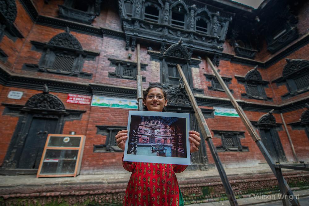 Nepal, Kathmandu, earthquake damage at Kathmandu Durbar Square. Photos of how the temples looked previously. Kumari House.