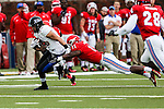 Tulsa Golden Hurricane wide receiver Conner Floyd (80) and Southern Methodist Mustangs linebacker Kyran Mitchell (11) in action during the game between the Tulsa Golden Hurricanes and the SMU Mustangs at the Gerald J. Ford Stadium in Dallas, Texas.