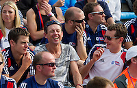 11 SEP 2011 - BEIJING, CHN - Alistair Brownlee (right) shares a joke with coach Jack Maitland (centre) as they wait for the competitors to reappear in the stadium during the 2011 Elite Womens ITU World Championship Series Grand Final Triathlon .(PHOTO (C) NIGEL FARROW)
