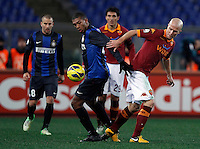 Calcio, semifinale di andata di Coppa Italia: Roma vs Inter. Roma, stadio Olimpico, 23 gennaio 2013..FC Inter defender Juan Jesus, of Brazil, left, is challenged by AS Roma midfielder Michael Bradley, of the United States, during the Italy Cup football semifinal first half match between AS Roma and FC Inter at Rome's Olympic stadium, 23 January 2013..UPDATE IMAGES PRESS/Isabella Bonotto