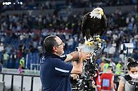 26th September 2021;  Stadio Olimpico, Rome, Italy; Italian Serie A football, SS Lazio versus AS Roma; Lazio Trainer Maurizio Sarri Holds the Lazio mascot eagle during the match Lazio-Roma at the Olimpico Stadium