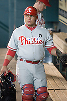 Philadelphia Phillies catcher Carlos Ruiz #51 in the dugout before the Major League Baseball game against the Houston Astros at Minute Maid Park in Houston, Texas on September 12, 2011. Houston defeated Philadelphia 5-1.  (Andrew Woolley/Four Seam Images)