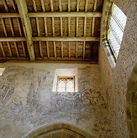 The chapel is adorned with medieval wall-paintings