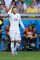 Adam Lallana of England looks dejected