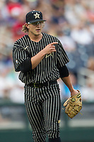Vanderbilt Commodores pitcher Carson Fulmer (15) warms up before the NCAA College baseball World Series against the Cal State Fullerton Titans on June 14, 2015 at TD Ameritrade Park in Omaha, Nebraska. The Titans were leading 3-0 in the bottom of the sixth inning when the game was suspended by rain. (Andrew Woolley/Four Seam Images)