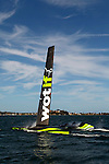 Australia's attempt to reclaim the 500m world speed sailing record..Pilot Sean Langman and co-pilot Joe Dekock testing the Wot Rocket for the world speed sailing record attempt at Belmont, Lake Macquarie..The Wot Rocket is half sailboat/sail plane; a nine meter long canoe style hull with two tiny foils, each about a sixth of the size of a Moth foil and a nine meter rigid sail, then a traverse beam out of an aerodynamic twin pod crew compartment. It is built entirely from carbon fiber  and weighs approximately 400 kilos.The difference between this sailboat/sail plane and any that have come before it is that it will be attempting to break through the water speed barrier using a technology as yet untried on any sailing craft - supercavitation - to reduce the drag which is around 1,000 times greater in the water than in air..Supercavitation will in effect mean Wot Rocket flies in a gas bubble created by the outward deflection of water by a specially shaped nose cone and the expansion of gases from its fin and foil design. By keeping water from contacting the surface of the body of Wot Rocket, this will significantly reduce drag and allow extremely high speeds. .The concept behind the Wot Rocket approach is to induce supercavitation at lower speeds where control can still be maintained and from there push through to the top speeds.Supercavitation means Wot Rocket should only require a fraction of the 45-50 knot winds that Albeau needed to go 0.39 knots better than the previous record. A moderate 18-20 knots should do the trick believes Langman.