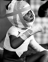 """Two battalions of Viet Cong systematically killed 252 civilians in a """"vengeance"""" attack on the small hemlet of Dak Son.  Tears are streaming down the face of little three-year-old Dieu Do, now homeless, and fatherless.  December 6, 1967.  (USIA)<br /> NARA FILE #:  3306-MVP-4-11<br /> WAR & CONFLICT BOOK #:  425"""