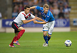 St Johnstone v FC Minsk...08.08.13 Europa League Qualifier<br /> David Wotherspoon fends off Milos Rnic<br /> Picture by Graeme Hart.<br /> Copyright Perthshire Picture Agency<br /> Tel: 01738 623350  Mobile: 07990 594431