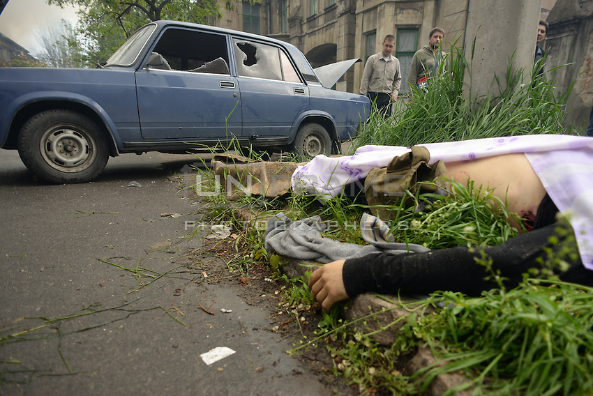 The corpse of a civilian shot dead  in the street nearby the Mariupol police headquarters. <br /> <br /> Ukraine's security forces claimed to have killed 21 pro-Russian separatists in Mariupol on one of the bloodiest military repression since the so called anti-terror operation's inception.