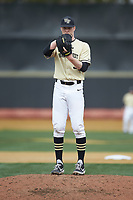 Wake Forest Demon Deacons relief pitcher William Fleming (38) looks to his catcher for the sign against the Notre Dame Fighting Irish at David F. Couch Ballpark on March 10, 2019 in  Winston-Salem, North Carolina. The Demon Deacons defeated the Fighting Irish 7-4 in game one of a double-header.  (Brian Westerholt/Four Seam Images)