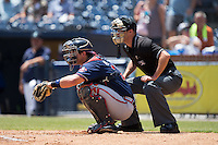 Rome Braves catcher Tanner Murphy (14) sets a target as home plate umpire Kyle Wallace looks on during the game against the Asheville Tourists at McCormick Field on July 26, 2015 in Asheville, North Carolina.  The Tourists defeated the Braves 16-4.  (Brian Westerholt/Four Seam Images)