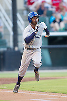 Raimel Tapia (15) of the Asheville Tourists hustles down the first base line against the Kannapolis Intimidators at CMC-NorthEast Stadium on July 12, 2014 in Kannapolis, North Carolina.  The Tourists defeated the Intimidators 7-5 in 15 innings.  (Brian Westerholt/Four Seam Images)