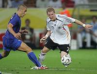 Bastian Schweinsteiger, Fabio Cannavaro.  Italy defeated Germany, 2-0, in overtime in their FIFA World Cup semifinal match at FIFA World Cup Stadium in Dortmund, Germany, July 4, 2006.