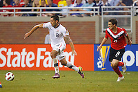 7 June 2011: USA Men's National Team forward Clint Dempsey (8) and Canada midfielder Will Johnson (8) during the CONCACAF soccer match between USA and Canada at Ford Field Detroit, Michigan. USA won 2-0.