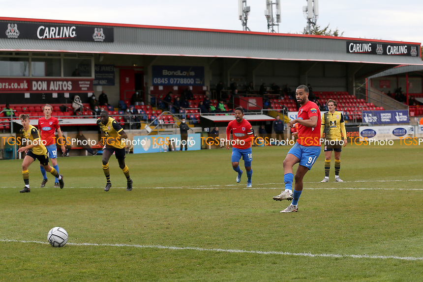 Paul McCallum of Dagenham and Redbridge scores the second goal for his team from the penalty spot during Dagenham & Redbridge vs Woking, Vanarama National League Football at the Chigwell Construction Stadium on 3rd May 2021
