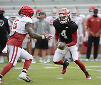 Arkansas quarterback Malik Hornsby (4) hands the ball off Saturday, April 3, 2021, to running back Raheim Sanders (5) during a scrimmage at Razorback Stadium in Fayetteville. Visit nwaonline.com/210404Daily/ for today's photo gallery. <br /> (NWA Democrat-Gazette/Andy Shupe)