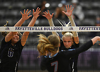Fayetteville Regan Harp (6) and Kennedy Phelan (4) block, Thursday, September 10, 2020 during a volleyball game at Fayetteville High School in Fayetteville. Check out nwaonline.com/200911Daily/ for today's photo gallery. <br /> (NWA Democrat-Gazette/Charlie Kaijo)