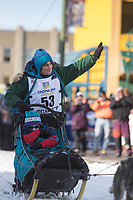Cindy Gallea and team leave the ceremonial start line with an Iditarider at 4th Avenue and D street in downtown Anchorage, Alaska on Saturday March 2nd during the 2019 Iditarod race. Photo by Brendan Smith/SchultzPhoto.com