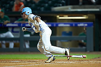 Logan Warmoth (7) of the North Carolina Tar Heels starts down the first base line against the Miami Hurricanes in the second semifinal of the 2017 ACC Baseball Championship at Louisville Slugger Field on May 27, 2017 in Louisville, Kentucky. The Tar Heels defeated the Hurricanes 12-4. (Brian Westerholt/Four Seam Images)