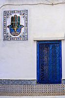 Ceramics, Sidi Bou Said, Tunisia.  Wall Panel of Tiles Showing the Hand of Fatima.