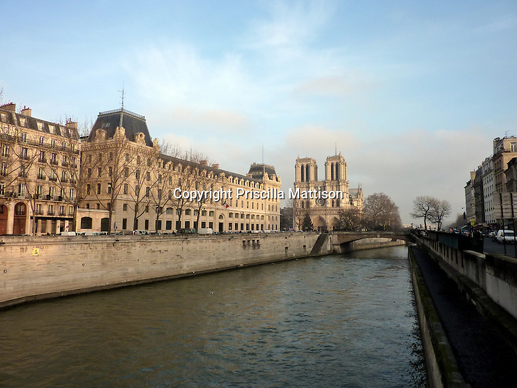 Paris, France - February 2, 2011:  The Seine leads to Notre Dame.