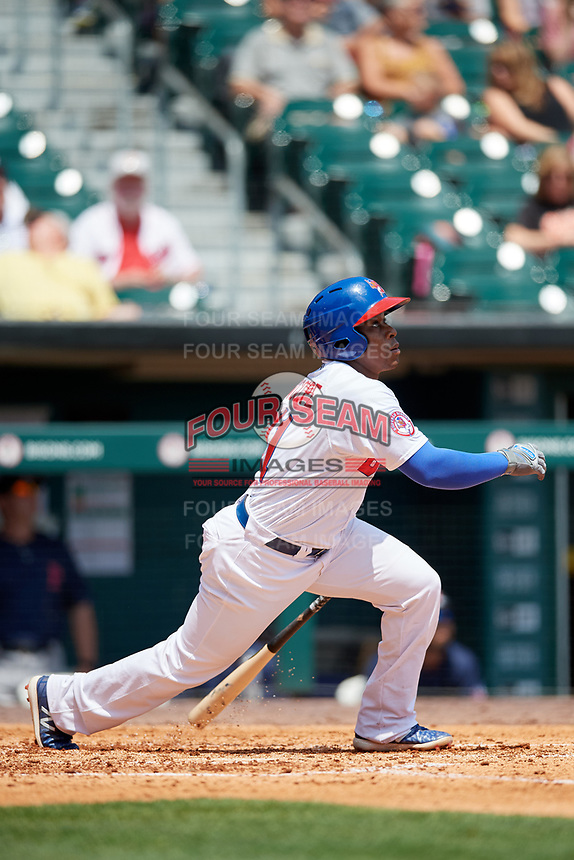Buffalo Bisons shortstop Gift Ngoepe (11) follows through on a swing during a game against the Pawtucket Red Sox on June 28, 2018 at Coca-Cola Field in Buffalo, New York.  Buffalo defeated Pawtucket 8-1.  (Mike Janes/Four Seam Images)